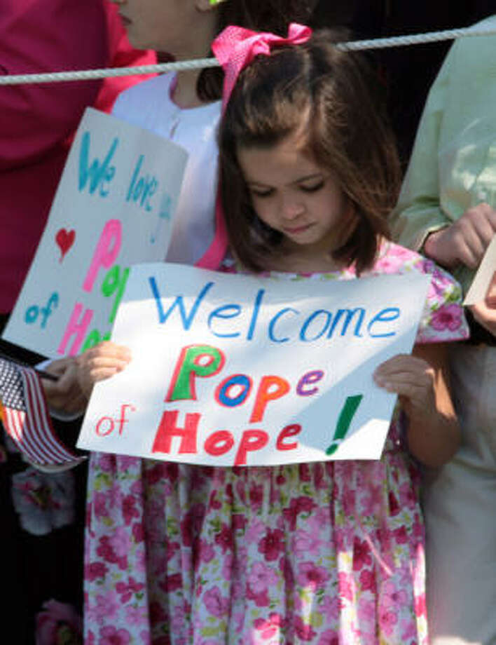 A young girl holds a sign greeting Pope Benedict XVI to the United States during a welcoming ceremony on the South Lawn of the White House in Washington, D.C. on Wednesday. Photo: George Bridges, MCT