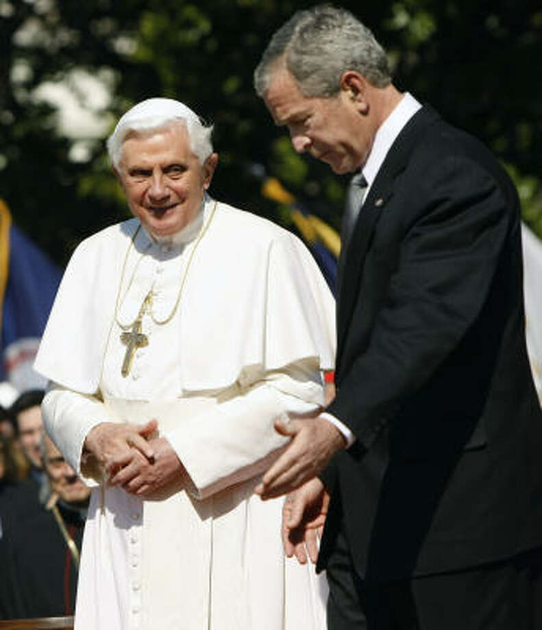 President Bush escorts Pope Benedict XVI to the podium during a South Lawn arrival ceremony at the White House in Washington on Wednesday. Photo: Gerald Herbert, AP