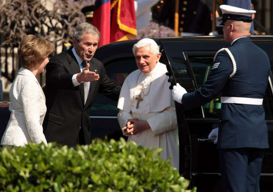 U.S. President George W. Bush and first lady Laura Bush welcome Pope Benedict XVI to the South Lawn of the White House in Washington, D.C., on Wednesday. Photo: George Bridges, MCT
