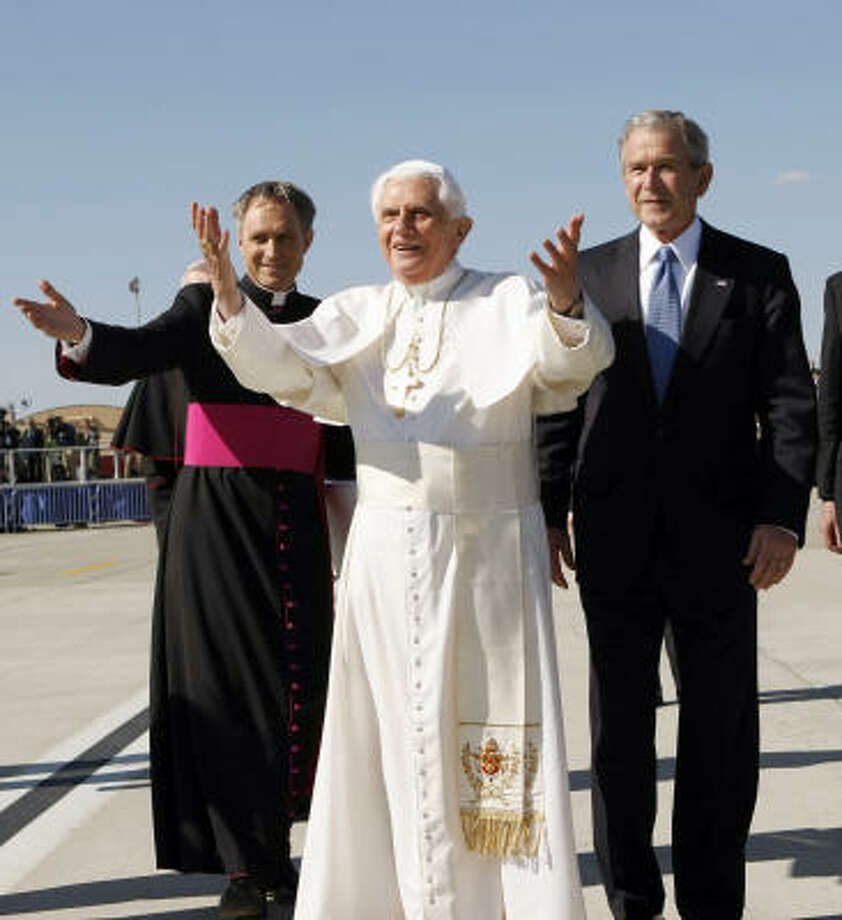President Bush escorts Pope Benedict XVI upon his arrival at Andrews Air Force Base in Maryland on Tuesday.  At left is Archbishop Timothy P. Broglio. Photo: Gerald Herbert, AP