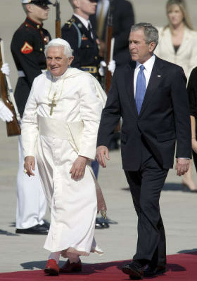 President Bush escorts Pope Benedict XVI, left, upon his arrival, Tuesday at Andrews Air Force Base in Maryland. Photo: Pablo Martinez Monsivais, AP