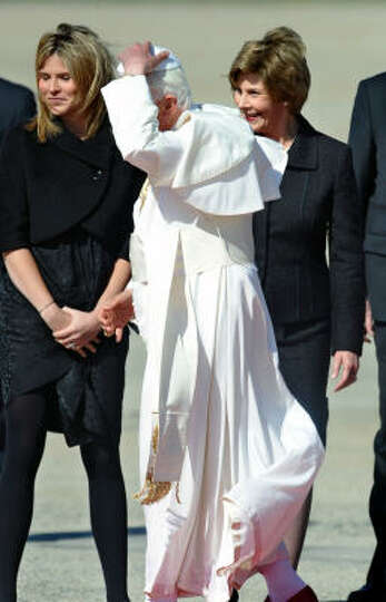 Pope Benedict XVI is greeted by US First Lady Laura Bush (R) and daughter Jenna (L) upon the Pope's