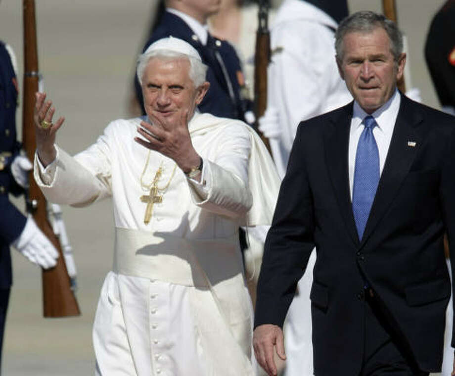 Pope Benedict XVI, left, walks with President Bush, right, during his arrival at Andrews Air Force Base on Tuesday. Photo: Pablo Martinez Monsivais, AP