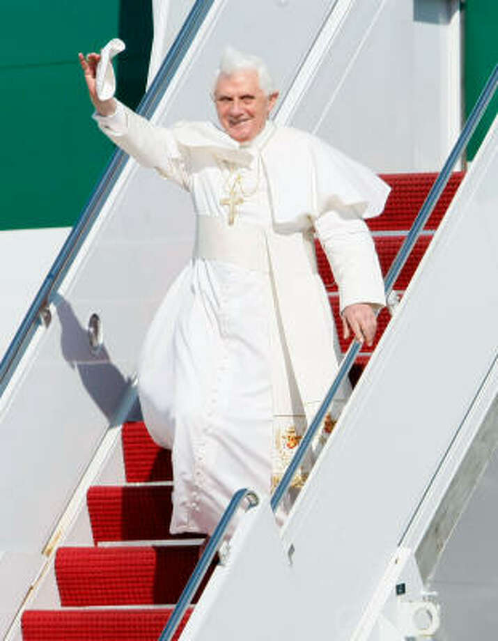 Pope Benedict XVI waves as he arrives in the United States on Tuesday at Andrews Air Force Base in Maryland. Pope Benedict will spend three days in Washington DC, including a visit to the White House tomorrow before continuing onto New York City. Photo: Win McNamee, Getty Images