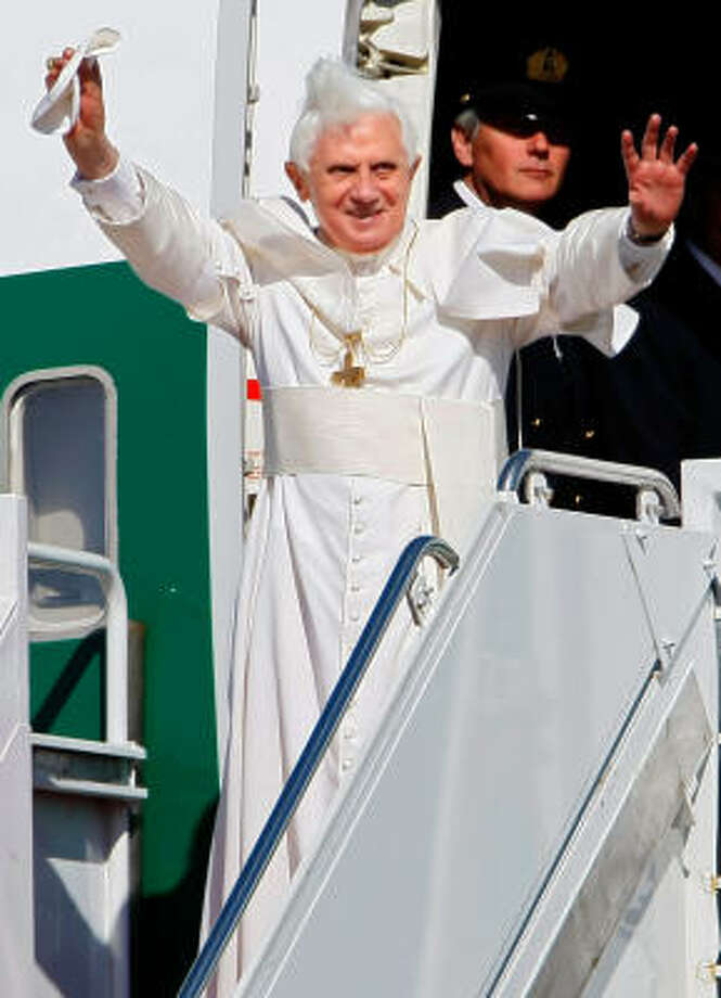 Pope Benedict XVI waves as he arrives in the United States on Tuesday. Pope Benedict will spend 3 days in Washington, DC, including tomorrow at the White House, before continuing on to New York City later in the week. Photo: Win McNamee, Getty Images