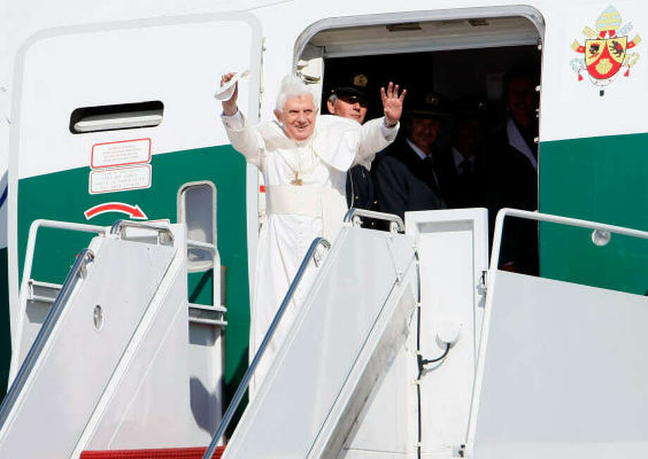 Pope Benedict XVI waves on Tuesday as he arrives in the United States at Andrews Air Force Base in Maryland. Pope Benedict will spend three days in Washington D.C., including a visit to the White House tomorrow before continuing onto New York City. Photo: Win McNamee, Getty Images