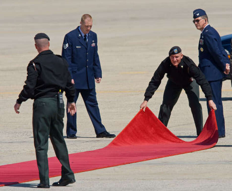 US Air Force officials on Tuesday un-roll the red carpet on a test run as final preparations continued for the arrival of Pope Benedict XVI at Andrews Air Force Base, Maryland. Photo: PAUL J. RICHARDS, AFP/Getty Images