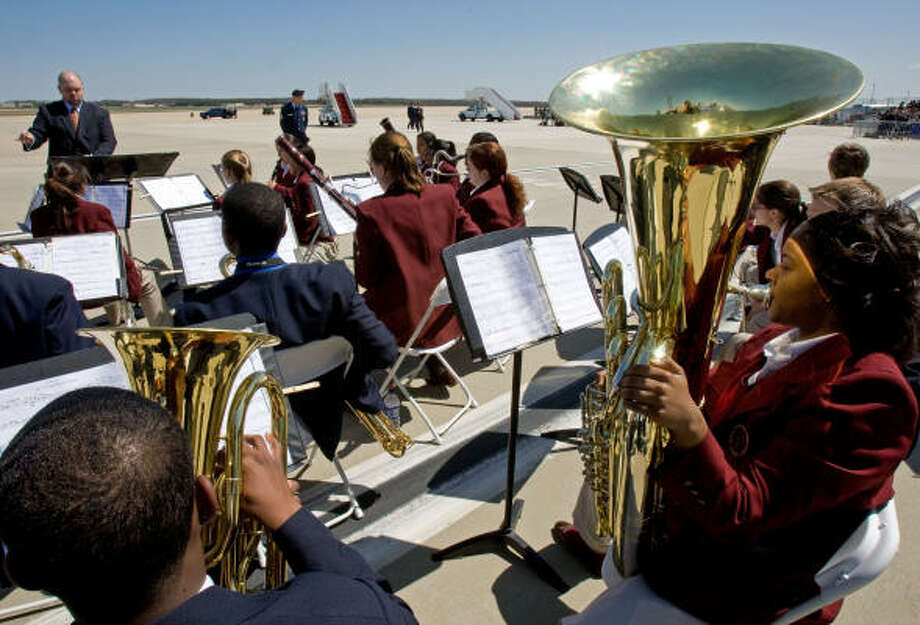 The Bishop McNamara High School band from Forestville, Maryland, as US Air Force personnel make preparations on Tuesday for the arrival of Pope Benedict XVI at Andrews Air Force Base, Maryland, where US President and Mrs. Bush will meet the Pontiff upon his Arrival for his first official visit to the US. Photo: PAUL J. RICHARDS, AFP/Getty Images