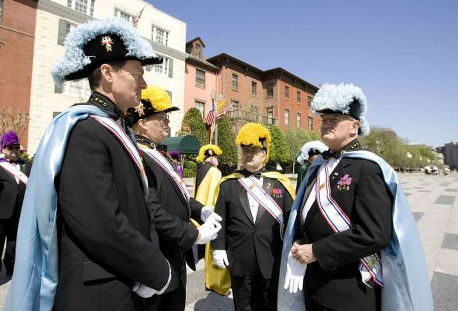 Members of the Knights of Columbus, from left, Paul Lambert, Richard Head, Anthony Fortunato, and Charles Gallina, gather on Tuesday along Pennsylvania Ave. across the White House. The Knights of Columbus are the honor guards for Pope Benedict XVI, who arrived Tuesday. Photo: Manuel Balce Ceneta, AP