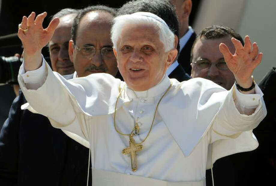 Pope Benedict XVI waves to photographers before leaving Fiumicino Airport, south-west of Rome on Tuesday for his first official visit to the United States that will include an address to the general assembly of the United Nations in New York. Photo: TIZIANA FABI, AFP/Getty Images