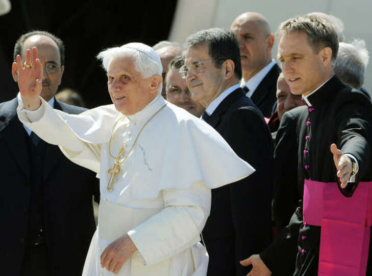 Pope Benedict XVI waves to photographers before leaving Fiumicino Airport, south-west of Rome on Tue
