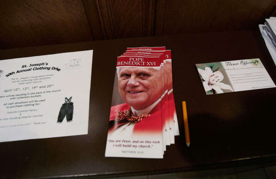 Fliers depicting Pope Benedict lie on a table at St. Joseph's Parish in New York on Monday.  Pope Benedict is scheduled to visit the church during his trip to the city this weekend. Photo: Chris Hondros, Getty Images