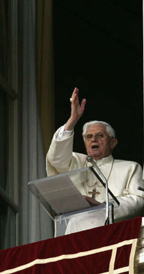 "Pope Benedict XVI delivers his blessing to the faithful gathered in St. Peter's Square at the Vatican, during the Regina Coeli from the window of his study on Sunday. The pontiff has asked the faithful to pray for the success of his coming trip to the United States and that his visit will be a ""time of spiritual renewal for all Americans."" Photo: Plinio Lepri, AP"