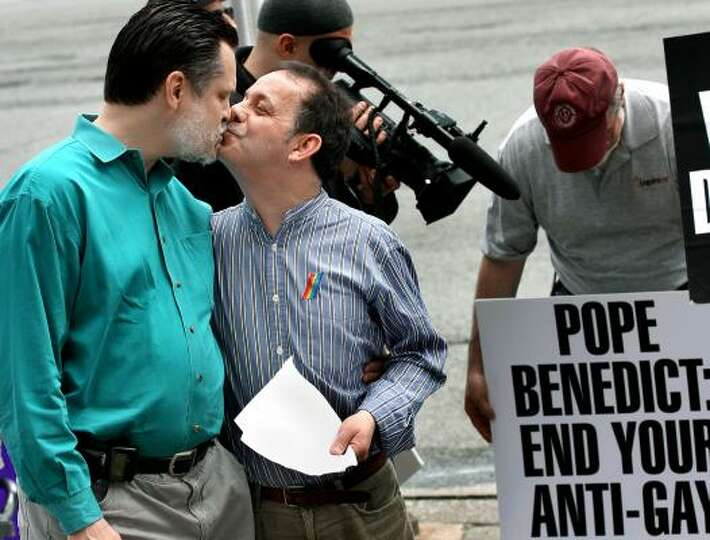 Tom Moulton, left, kisses his husband Brendan Fay, who are from New York City and were legally marri