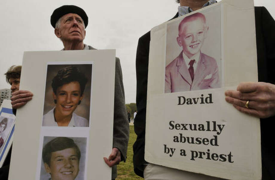 James Delivin, left, and members of the Survivors Network of those Abused by Priests and BishopAccountability.org, participate in a news conference and vigil to release a list of U.S. bishops who have been publicly accused of sex abuse and call on the pope to take action, on Sunday in Washington. Photo: William B. Plowman, AP