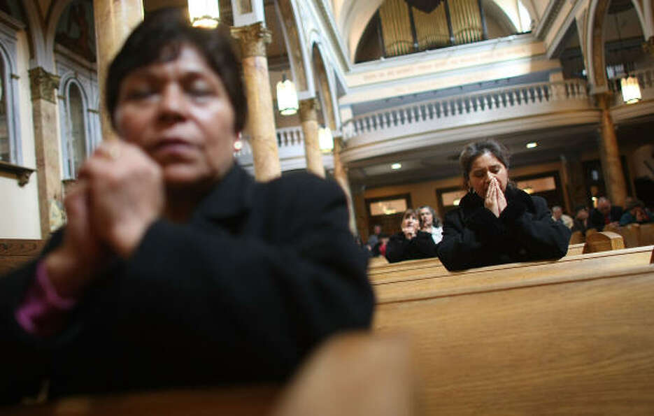Parishioners pray on Sunday in Mary Help of Christians Church in New York City, which they hope will