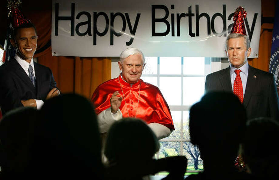 People inspect wax figures of Pope Benedict XVI (C), Democratic presidential candidate Sen. Barck Obama (D-IL) (L), U.S. President George W. Bush (R) which are on display at Madame Tussauds Wax Museum on Thursday in Washington, DC. The museum is holding an early party for Pope Benedict XVI to honor his April 16th birthday and his visit to the U.S. next week. Photo: Mark Wilson, Getty Images