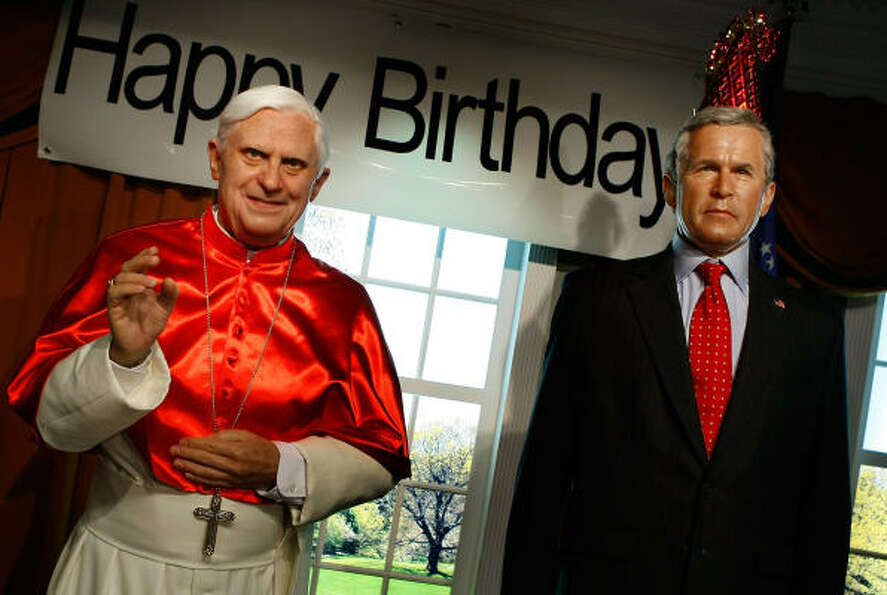 Wax figures of Pope Benedict XVI (L) and U.S. President George W. Bush are on display at Madame Tuss