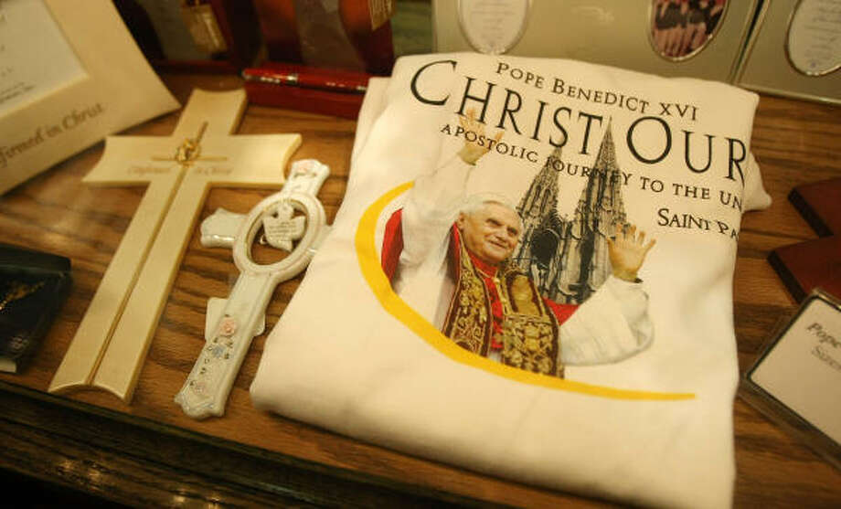 A Pope Benedict XVI commemorative t-shirt is put out for sale in Saint Patrick's Cathedral in midtown Manhattan on Wednesday. The Pope will arrive in the city on April 18 with stops including the United Nations, Saint Patrick's Cathedral and Yankee Stadium before departing April 20. Photo: Mario Tama, Getty Images