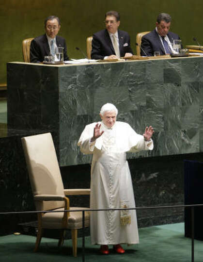 Pope Benedict XVI acknowledges delegates inside the United Nations General Assembly Hall at the Unit