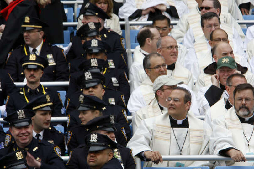 Police and clergy gather on Sunday for the Mass by Pope Benedict XVI at Yankee Stadium in New York.