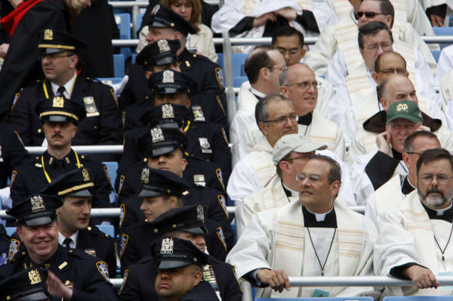Police and clergy gather on Sunday for the Mass by Pope Benedict XVI at Yankee Stadium in New York. Benedict was to celebrate Mass for 55,000 people at Yankee stadium before ending his United States trip. Photo: MIKE SEGAR, AFP/Getty Images