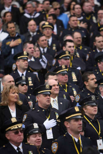 NYPD officers sing during the performance of 'God Bless America', before Pope Benedict XVI celebrate