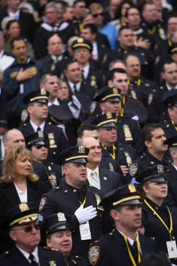 NYPD officers sing during the performance of 'God Bless America', before Pope Benedict XVI celebrated a Mass at Yankee Stadium. Photo: CHANG W. LEE, AFP/Getty Images