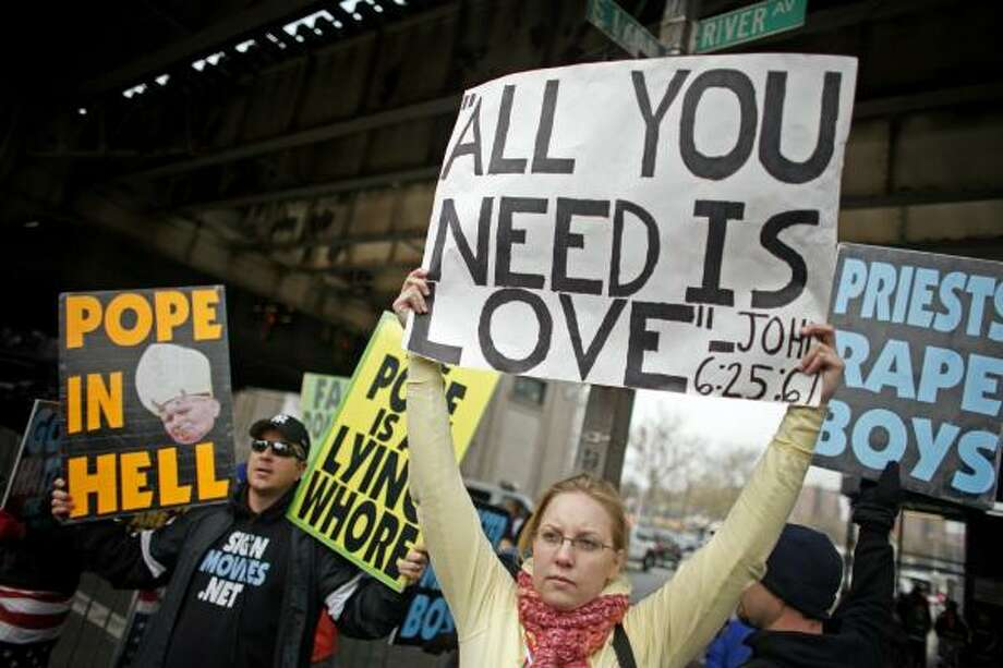 Conflicting groups of protestors demonstrate outside before a Mass celebrated by Pope Benedict XVI at Yankee Stadium on Sunday. Photo: Jason DeCrow, AP