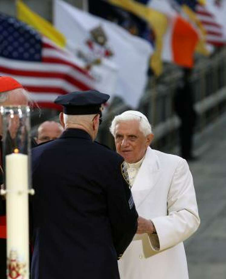 Pope Benedict XVI meets with a first responder of the Sept. 11 attacks after praying and lighting a candle at Ground Zero in New York on Sunday. Photo: Kathy Willens, AP
