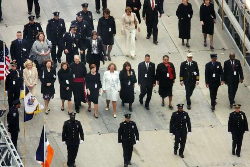 Family members of victims of the Sept. 11, 2001, attacks, clergy and officials walk down a ramp towa