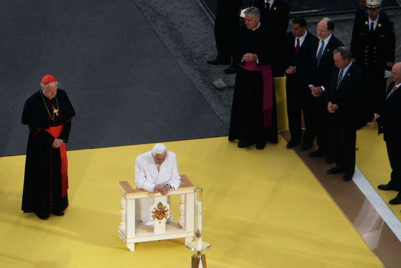 Cardinal Edward Egan, left, watches Pope Benedict XVI pray as New York Gov. David Paterson, New Jers