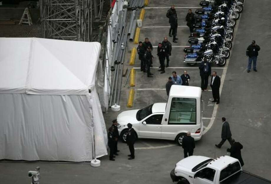 The pope mobile enters a security tent at the World Trade Center site on Sunday, April 20, 2008 before the arrival of Pope Benedict XVI. Photo: Mark Lennihan, AP