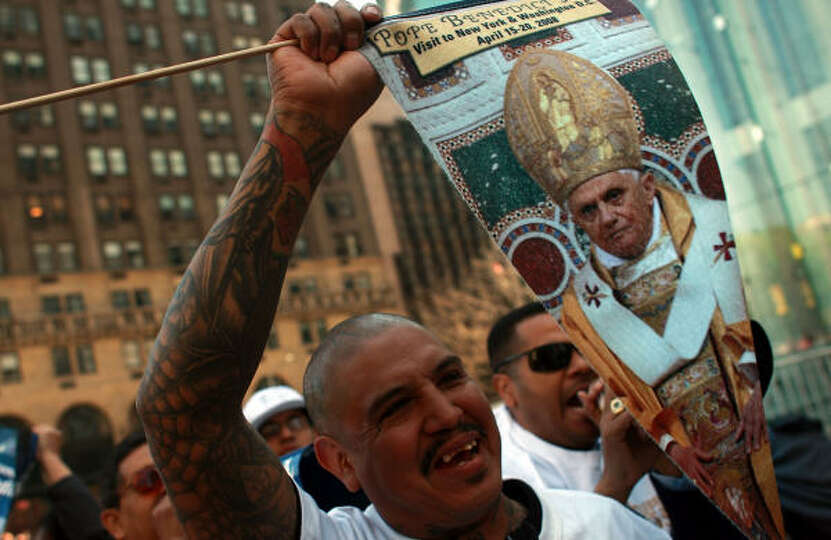 Mario Montiel of Clinton, Connecticut waits for Pope Benedict XVI on 5th Avenue in New York City.