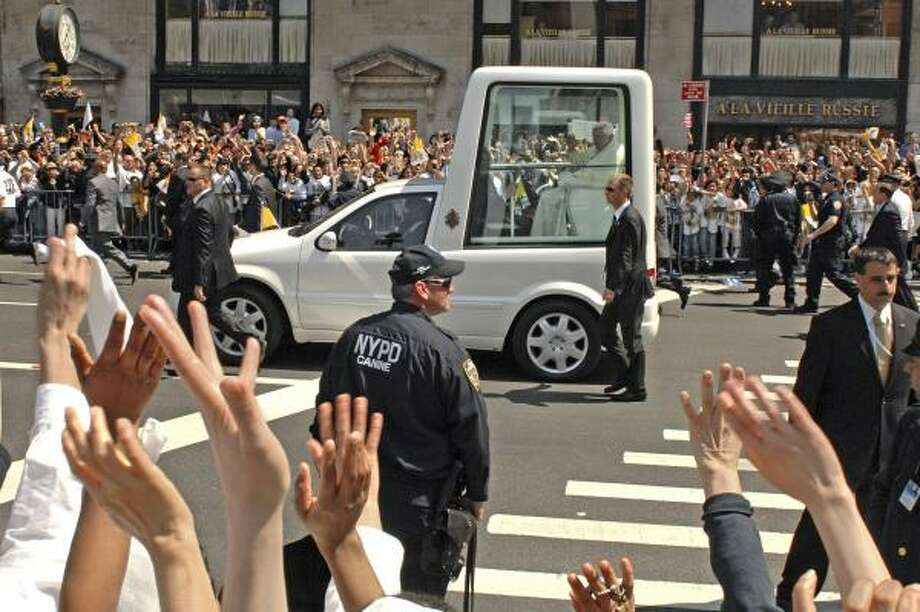 Pope Benedict XVI rides up Fifth Avenue in his popemobile after celebrating Mass at St. Patrick's Cathedral in New York. Photo: Louis Lanzano, AP