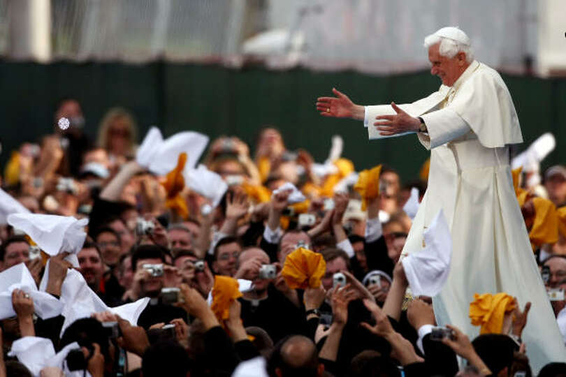 Pope Benedict XVI greets the audience after arriving for a Young Catholics Youth Rally held at Saint