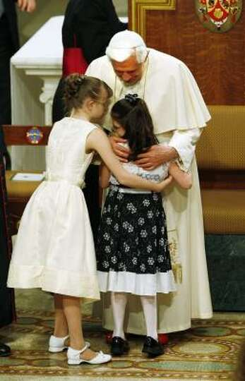 Pope Benedict XVI blesses a child during a ceremony in the chapel at St. Joseph's Seminary in Yonker