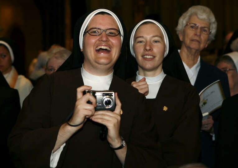 Nuns cheer as Pope Benedict XVI enters St. Patrick's Cathedral in New York to celebrate Mass on Satu