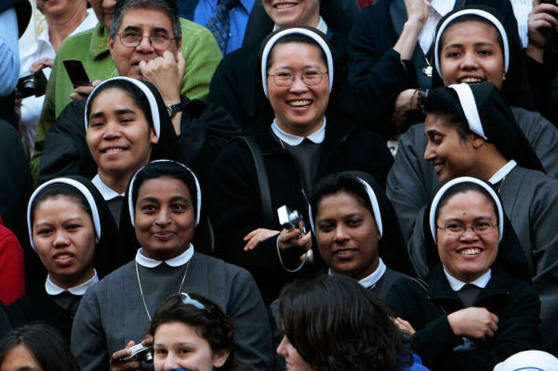 Catholic nuns smile in front of St. Patrick's Cathedral in advance of a Mass with Pope Benedict XVI