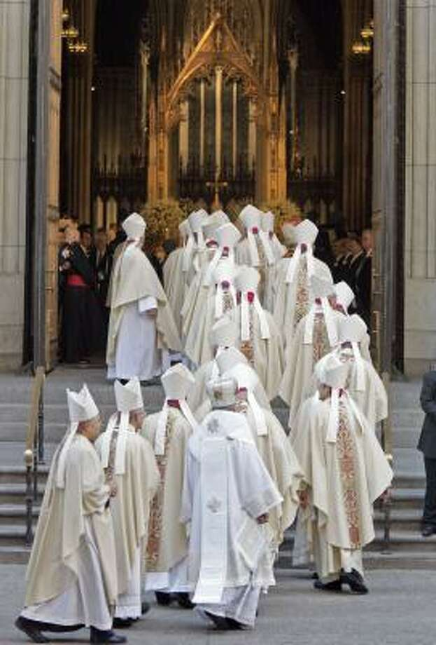 Bishops arrive to attend Mass with Pope Benedict XVI at New York's St. Patrick's Cathedral on Saturday. Photo: Richard Drew, AP
