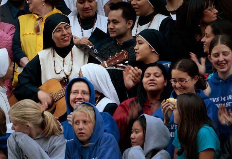 Catholic nuns sing in front of St. Patrick's Cathedral in advance of a Mass with Pope Benedict XVI o