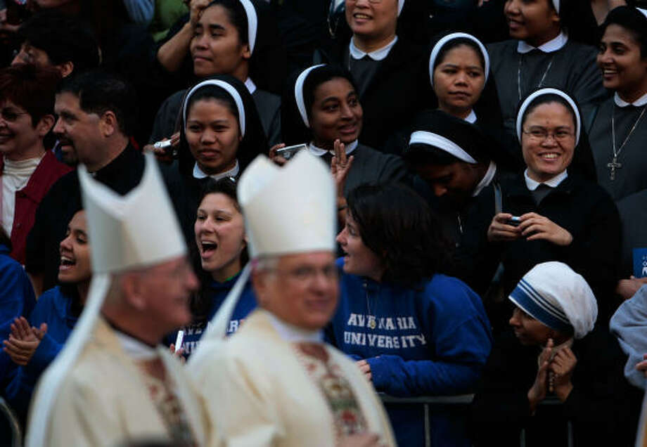 Nuns and others watch Catholic bishops file into St. Patrick's Cathedral in advance of a Mass with Pope Benedict XVI on Saturday in New York. Photo: Chris Hondros, Getty Images