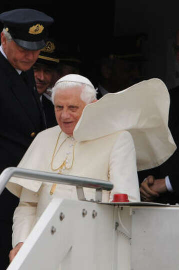 Pope Benedict XVI gets out of the specially chartered Alitalia plane on Monday as he arrives at Rome