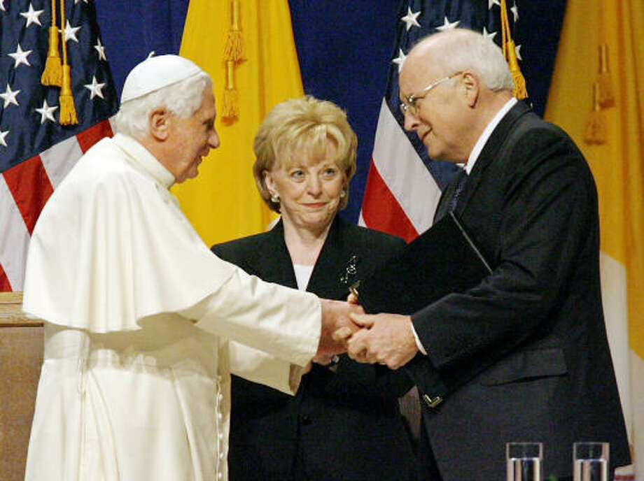 Pope Benedict XVI says farewell to Vice President Dick Cheney as his wife Lynne, center, look on, at New York's JFK International Airport, during a farewell ceremony on Sunday. Photo: Stuart Ramson, AP
