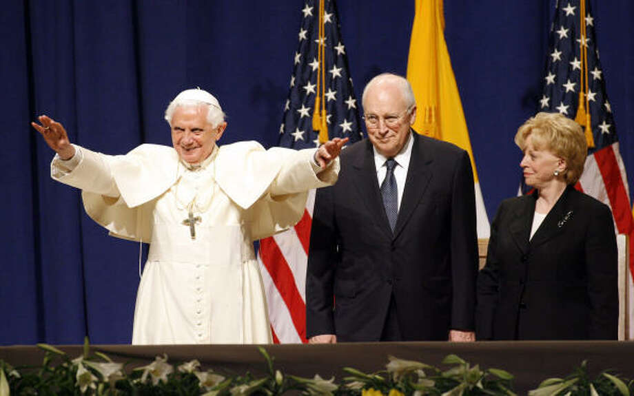 Pope Benedict XVI gestures to the crowd at New York's John F. Kennedy International Airport, as Vice President Dick Cheney and his wife Lynne look on, during a farewell ceremony at the conclusion of the Pope's visit to the U.S., on Sunday. Photo: Stuart Ramson, AP