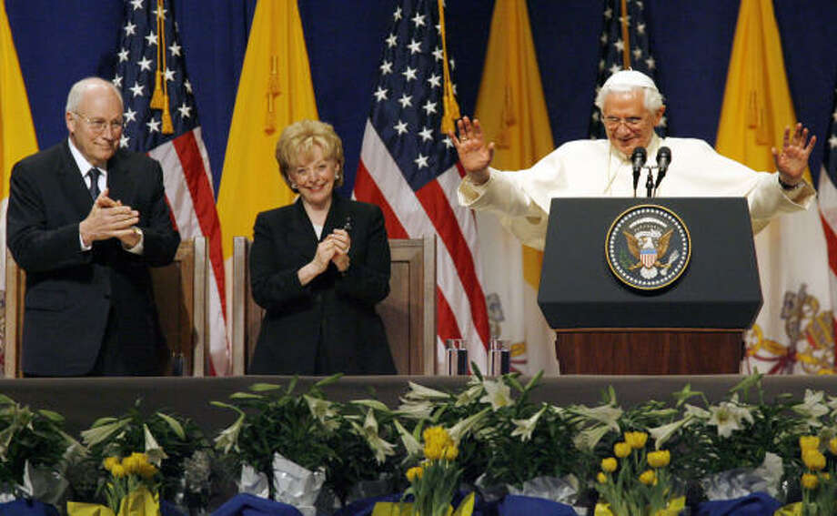 Pope Benedict XVI gestures to the faithful at New York's JFK International Airport, as Vice President Dick Cheney and his wife Lynne look on, during a farewell ceremony on Sunday. Photo: Stuart Ramson, AP