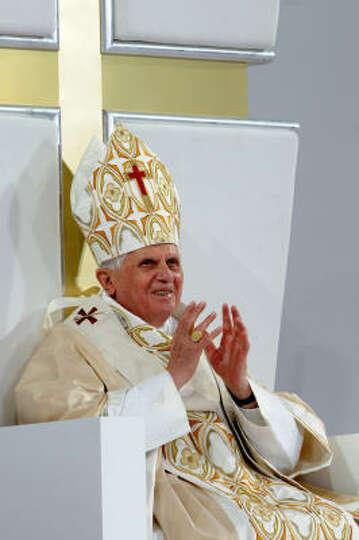 Pope Benedict XVI acknowledges the 58,000 faithful attending Mass at Yankee Stadium on Sunday.