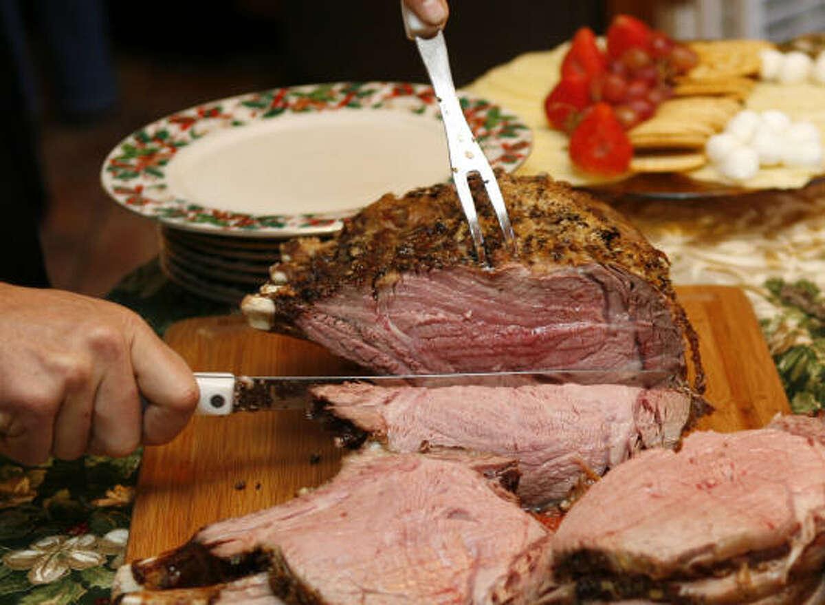Blanca Laurenzo's Beef Rib Roast is sliced and served with horseradish sauce.