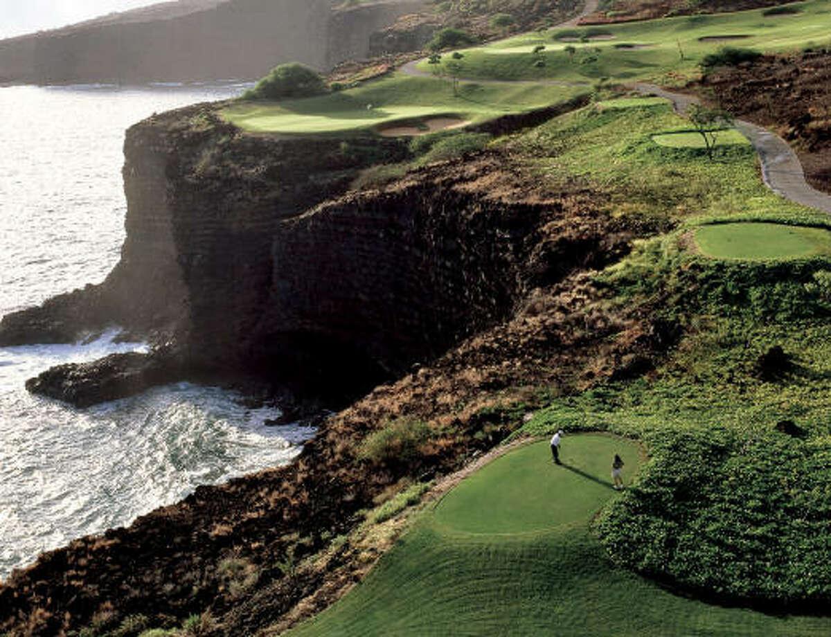 Golfers enjoy a spectacular view at the Four Seasons Resort Lanai at Manele Bay.