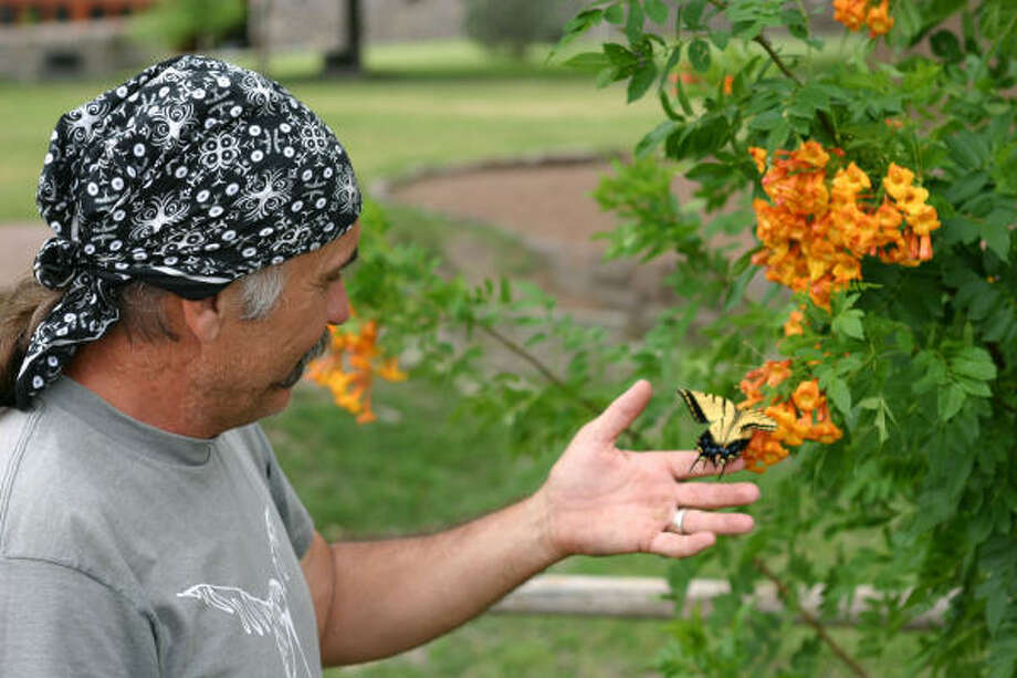 Cibolo Creek Ranch is the site of many special events, including a recent workshop by award-winning photographer Wyman Meinzer. Here he positions a swallowtail butterfly for students to practice closeup photography. Photo: TRACY BARNETT, San Antonio Express-News